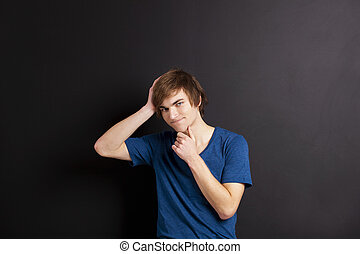 Young man thinking - Portrait of a young man thinking over a...