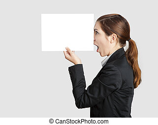 Pinocchio nose - Woman holding a paper sheet with a sketch...