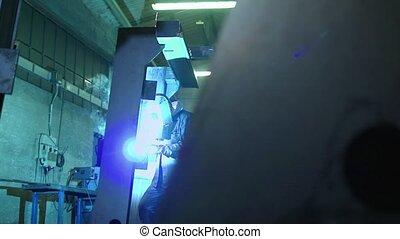 Man at work as welder in industry - Manual worker in steel...