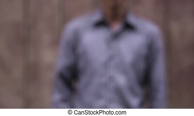 Portrait of mid adult asian man walking into the frame and...