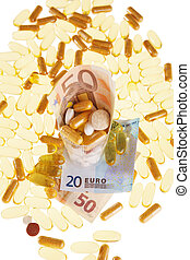 Pills and the euro on a white background