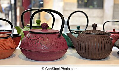 Several teapots displayed next to each other