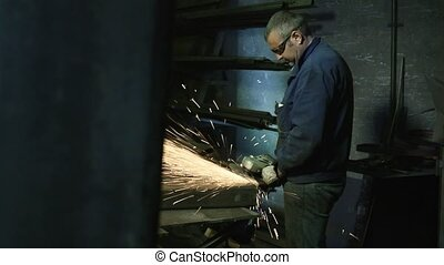 Man at work in steel factory - Manual worker in heavy...