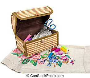 handmade embroidery and box on white background