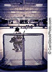 Ice Hockey Goalie - Young ice hockey goalie waiting in net