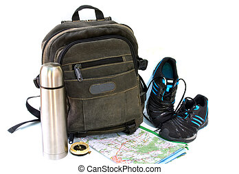 knapsack with sneakers against white background