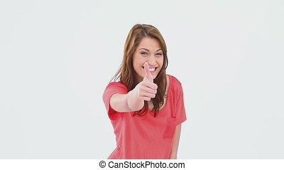 Brunette haired woman giving the thumb-up