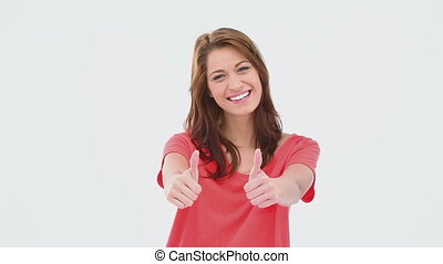 Redhead giving the thumbs-up against white background