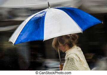 Woman under blue striped umbrella - Woman under blue and...