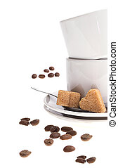 Cup of coffee and sugar isolated on white background.