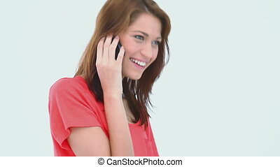 Brunette haired woman on the phone