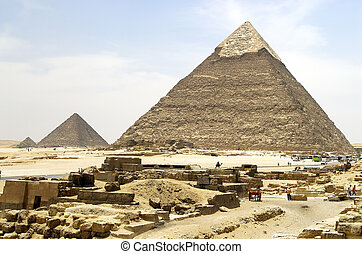 Pyramids in Giza - Giza Pyramids with stones in front