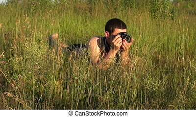 The photographer in the grass.