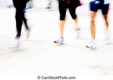 Runners legs with panning blur. horizontal frame.