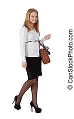 Young woman with handbag against a white background.