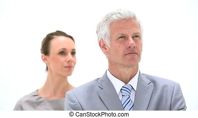 Boss standing with his secretary against a white background