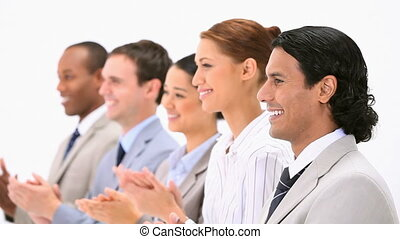Business people applauding against a white background