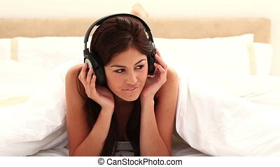 Happy brunette listening to music