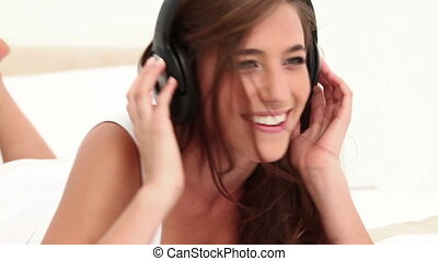 Smiling young woman bobbing in her bedroom