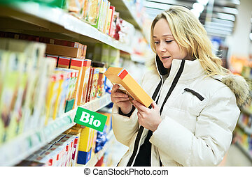 woman making bio food shopping at grocery store - woman...
