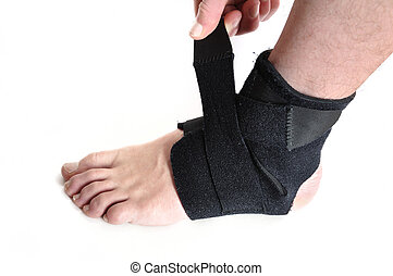 Wrapping a Black Ankle Brace Isolated on White