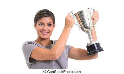Woman holding a trophy against white background