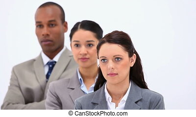 Business people in line against a white background