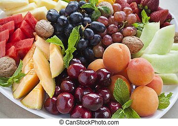 Summer fruit platter - Colorful summer fruit platter with...