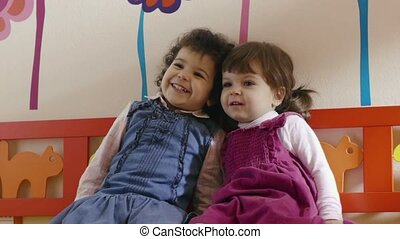 Two little children play and laugh