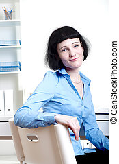 Businesswoman works at office - Portrait of a business woman...
