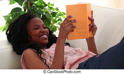 Happy woman reading a novel