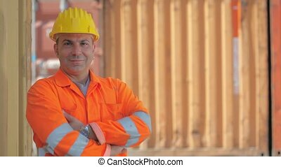 Happy manual worker smiling - Portrait of mid adult worker...