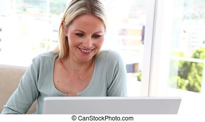 Blonde woman using video chat