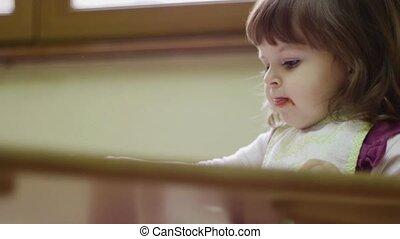 Baby girl having lunch at school - Preschooler eating lunch...