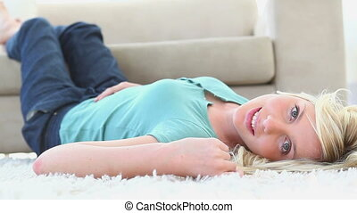 Woman lying on a carpet