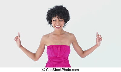 Woman in pink pointing up against white background