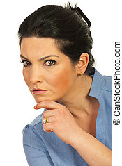 Serious executive woman looking you - Head shot of serious...
