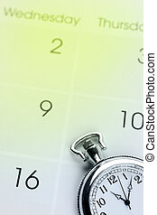 Time management - Pocket watch on calendar page