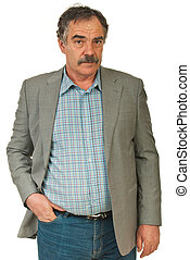 Serious senior business man standing with hand in jeans...
