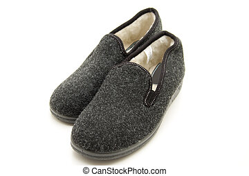 Gray slippers with felt layer on white background
