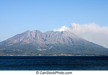 Active volcano and volcanic plume facing the sea called...