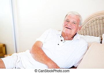 happy senior man lying on bed