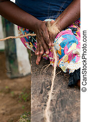 Female hands make a corn from coconut copra fibre - Female...