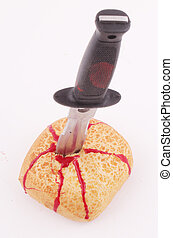 bread roll - A bread roll with a knife and traces of blood