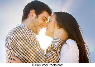 Romantic kiss - Close up portrait of young couple showing...