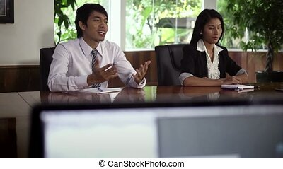 Young people during job interview - Young Asian man and...