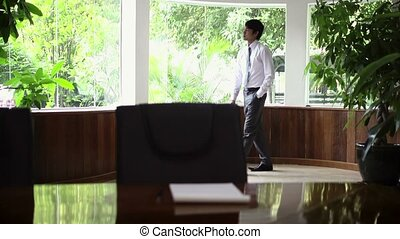 Worried young Asian manager at work - Young Asian man at...