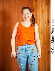 Mature woman shows beaded jeans - Mature woman shows a...