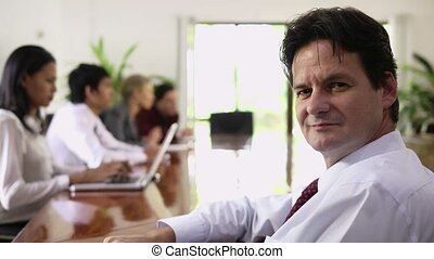 Businessman looking at camera - Mature man working as...