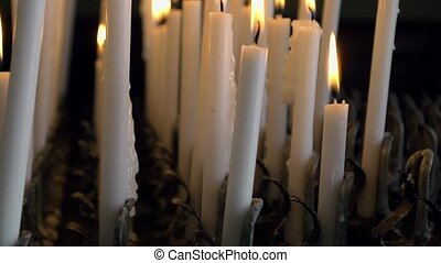 Wax candles in church - Wax candles burning in catholic...